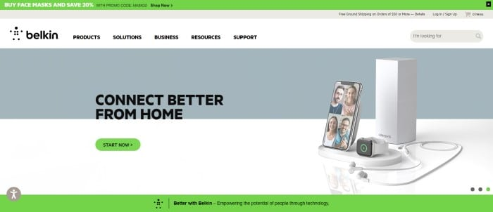 This screenshot of the home page for Belkin has a green header above a white navigation bar with black text, which is above a gray and white section with a display of home connection products on the right side of the page and black text with a green call to action button on the left side of the page.