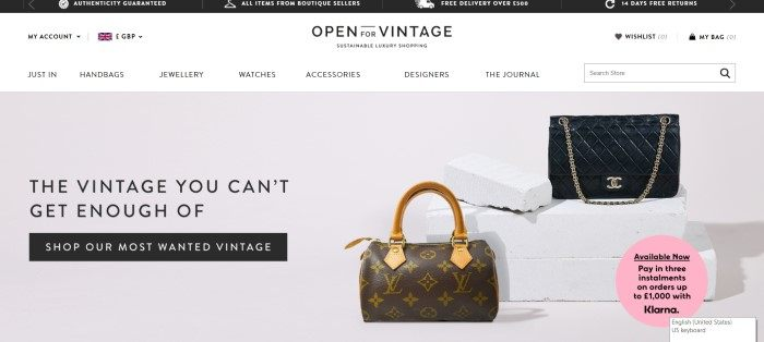 This screenshot of the home page for Open For Vintage has a black header, a white navigation bar with black text, and a light gray main section with photos of designer handbags on the right side of the page with black text and a black call to action button on the left side of the page.