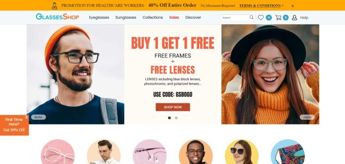 This screenshot of the home page for GlassesShop has an orange header, a gray navigation bar with a blue and orange logo and black text, and a main section with a photo of a smiling man in black frame glasses on the left side of the page, an announcement section with black and orange text in the middle of the page, and a photo of a smiling woman in plastic frames, an orange sweater, and a black hat on the right side of the page.