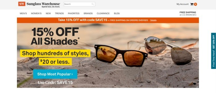 This screenshot of the home page for Sunglass Warehouse has a gray header, a white navigation bar with black lettering, an orange announcement bar, and photo of two different pairs of sunglasses lying in the sand, next to black text, yellow highlighted black text, and a blue call to action button.