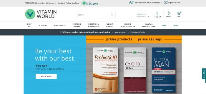 This screenshot of the home page for Vitamin World has a gray header, a white navigation bar with black text and a green logo, a black announcement bar, a blue text section on the left side of the page with white and black text and a white call to action button on the left side of the page, and a photo showing three supplement products in boxes with the Vitamin World logo on them on the right side of the page, along with an orange sales bar.