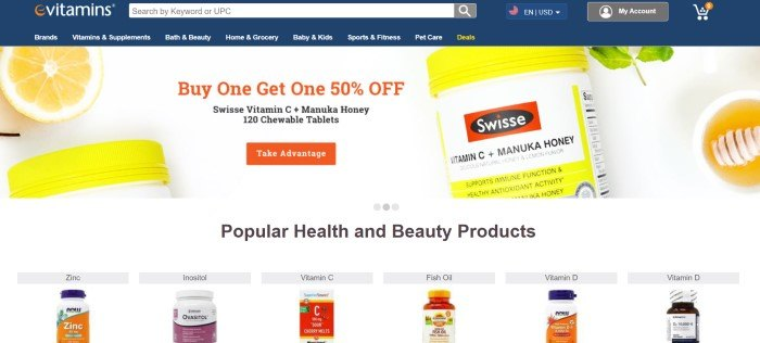 This screenshot of the home page for eVitamins has a dark blue header and navigation bar with white text above a photo with a white background, cut lemons, and yellow and white jars of a vitamin C supplement, along with orange and black text and an orange call to action button.