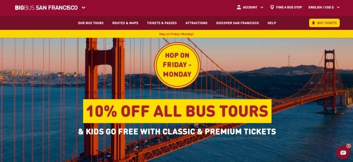 The screenshot of the home page for Big Bus San Francisco has a dark red header and navigation bar with white text, a yellow announcement bar, and a large photo of the Golden Gate Bridge with a yellow circular and a yellow rectangular announcement section with red text, as well as white text overlaying the picture.