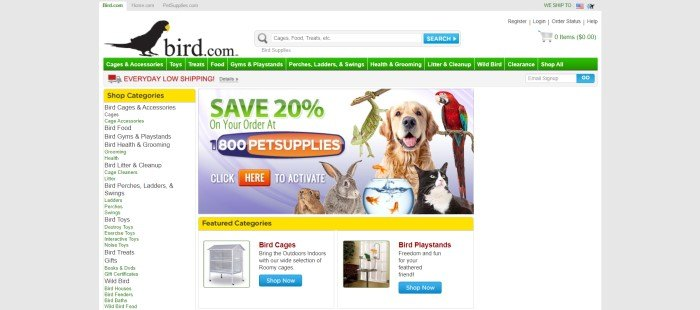 This screenshot of the home page for Bird.com has a gray background with a white main section that includes a blackbird logo, a green navigation bar with white text, a category list down the left side of the page, and a photo of several pets, including birds, in the main section, along with green and white text with blue and orange elements above a row of featured categories, including a small photo of a bird cage and a small photo of a bird play stand.