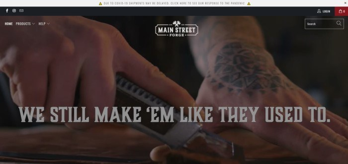 This screenshot of the home page for Main Street Forge has a gray header above a large photo showing a man's hands holding a specialty tool as he slices through a sheet of leather, along with white text.