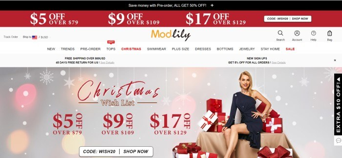 This screenshot of the home page for Modlily has a black and red header with white text, a white background, black and red text in the navigation bar, and a main section with a photo of a smiling blonde woman in a black dress sitting on a pile of white, red, and gold presents, along with red and white text and a white call to action button.