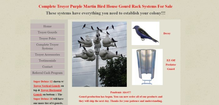 This screenshot of the home page for Troyer Systems has a tan background with orange and black text above a photo of a Purple Martin colony, a photo of a decoy, and a photo of a predator guard on the right side of the page, as well as a list of shopping categories along the left side of the page.