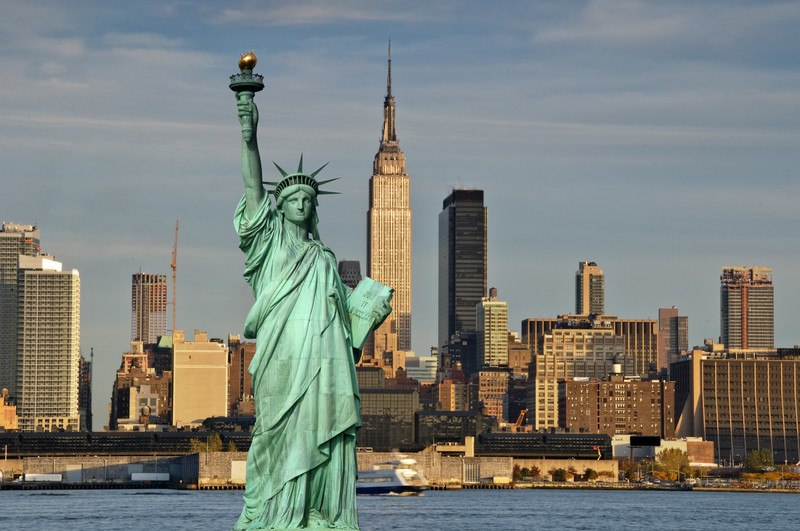 This photo shows the New York City skyline, including the Empire State Building and the Statue of Liberty, representing the best New York City affiliate programs.