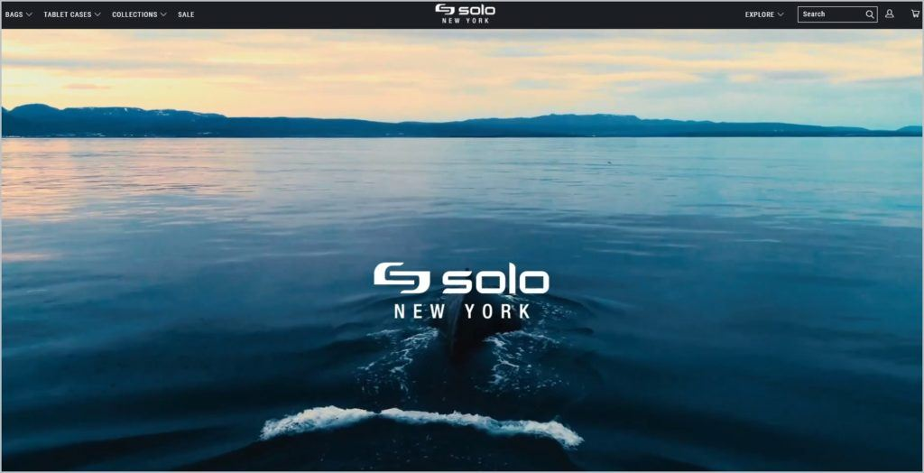 This screenshot of Solo New York homepage shows a black header with the navigation menu and name of the website at the center, all in white font, main image showing a whale in the ocean with ranges of mountain in the horizon, with Solo New York name and logo on it.
