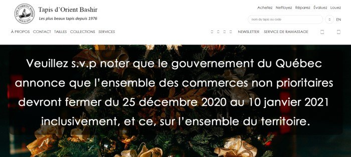 This screenshot of the home page for Bashir Persian Rugs has a white header above a dark filtered photo of pine branches and Christmas decorations behind white text, with all the text on the page showing up in French.