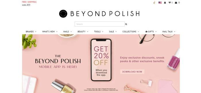 This screenshot of the home page for Beyond Polish has a white background, black text in the header and navigation bar, and a large pink-background overhead photo showing a mobile device with the Beyond Polish shopping app on its screen, as well as partial images around it that include a green plant, a cup of coffee, glasses, paper clips, and nail polish, as well as black and purple text and a purple call to action button.