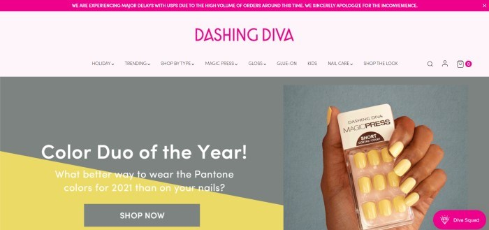 This screenshot of the home page for Dashing Diva has a magenta header, a magenta logo in a pale pink navigation bar with black text, and a large gray main section with a photo of a woman's hand on the right holding yellow press on nails, with a gray and black graphic section on the left behind white text and a gray call to action button.