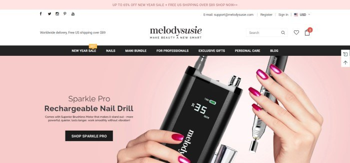 This screenshot of the home page for Melodysusie has a pink header, a white search bar, a black navigation bar, and a pink main section with black text, a black call to action button, and a woman's hands with pink fingernails holding a black nail drill.
