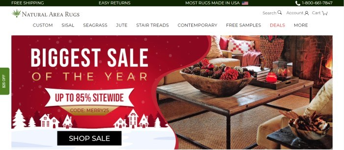 This screenshot of the home page for Natural Area Rugs has a black header with white text, a white navigation bar with black text, and a main section with a red, white, and gold graphic announcement section with a black call to action button on the left side of the main section and a photo of a wooden coffee table on a natural area rug in a comfortable living room on the right side of the main section.