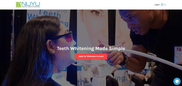 This screenshot of the home page for Nuyu has a white header with a blue and green logo above a photo of a woman getting a teeth whitening treatment in a clinical setting, behind white text and an orange call to action button.