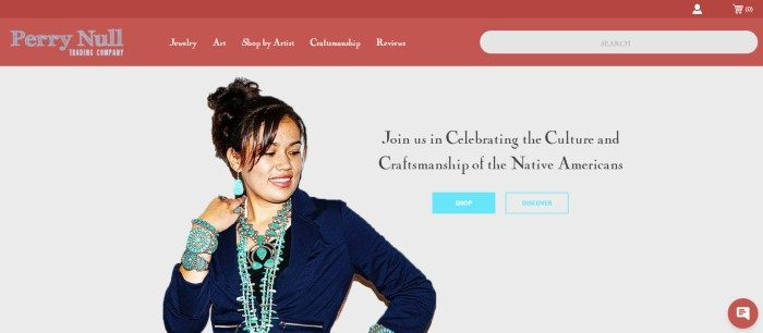This screenshot of the home page for Perry Null Trading Company has a burnt orange navigation bar and search bar with white text above a white main section with a photo of a smiling dark haired woman in a dark suit and heavy turquoise jewelry, next to black text and blue call to action buttons.