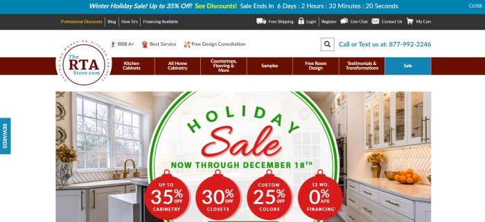 This screenshot of the home page for The RTA Store has a blue header, three varied navigation bars in black, white, and maroon, and a main section showing a beautiful kitchen behind a large white, red, and green graphic announcing holiday sales.