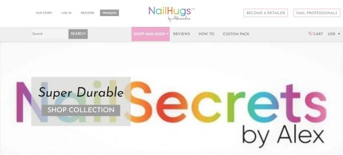 This screenshot of the home page for Nail Hugs has a white background, a multicolored logo at the top and center of the page, navigation areas in gray and pink, and a white main section with multicolored text and a gray call to action button.