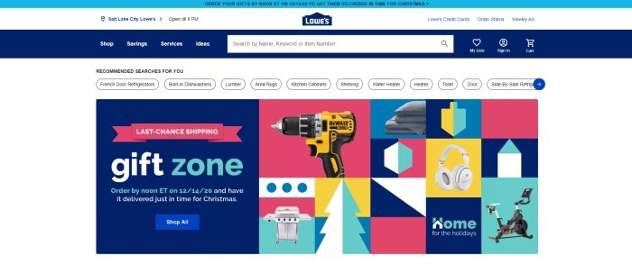 This screenshot of the home page for Lowes has a blue header, a white navigation bar, a blue navigation bar, and a third white navigation bar above a graphic main section in pink, blue, aqua, and yellow with a small photo of a drill and a few other small product photos, with a blue announcement section on the left side of the page with text in white and aqua, along with a blue call to action button.