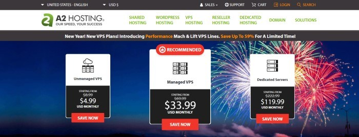 This screenshot of the home page for A2 hosting has a black header, a white navigation bar with green and black text, a black announcement bar with white and orange text, and a blue main section with a row of three white windows that include black text and icons with red call to action buttons, overlaying fireworks graphics on the right side of the page.