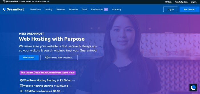 This screenshot of the home page for DreamHost has a black announcement bar and a blue filtered photo of a smiling woman as a background for the main section, behind white text, a blue call to action button, and a purple call to action button.