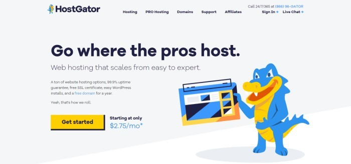 This screenshot of the home page for HostGator as a pale gray background, black text throughout the page, and graphic elements that include a blue and orange alligator holding a laptop, along with an orange call to action button.