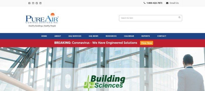 This screenshot of the home page for Pure Air Control Services has a white header and search bar, a blue navigation bar with white text, a red announcement bar with white text, and a large photo of an indoor office building with a man walking on the left side of the page, behind black and green text.