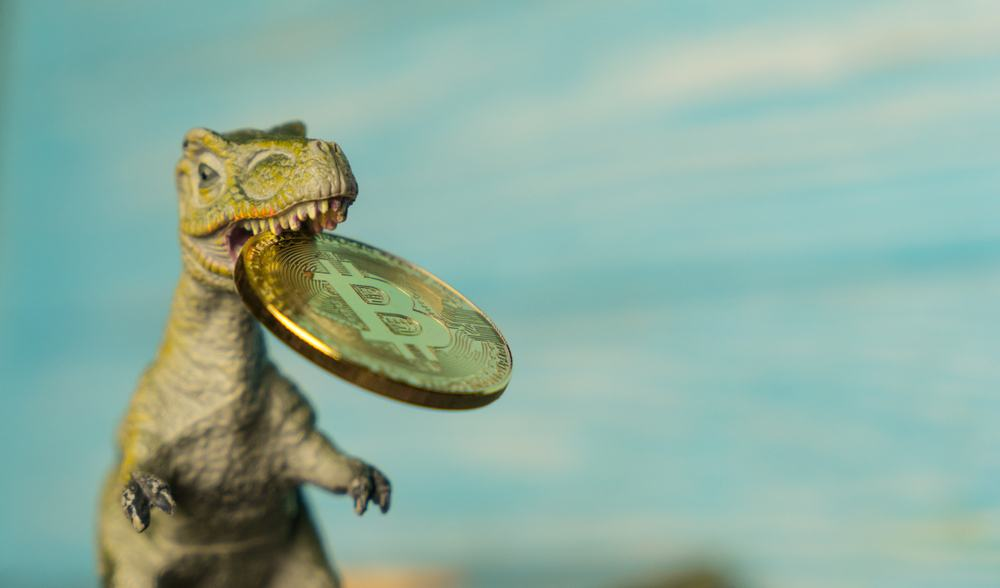 Dinosaur with bitcoin in mouth to represent risk of losing money