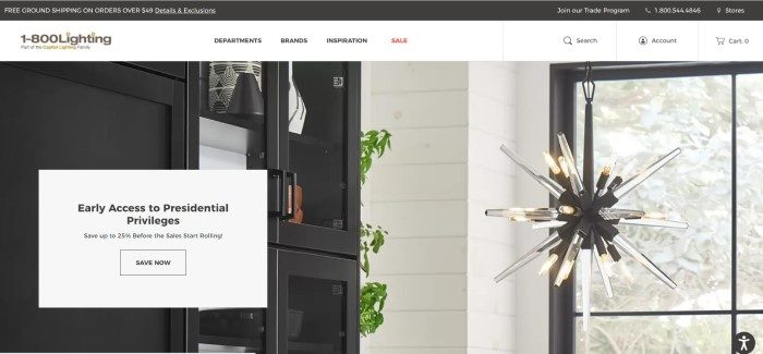 This screenshot of the home page for Capitol Lighting has a black header, a white navigation bar, and a photo of an interesting light fixture hanging near some black cabinets and a window, along with a white text window on the left side of the page that contains black text and a white call to action button.