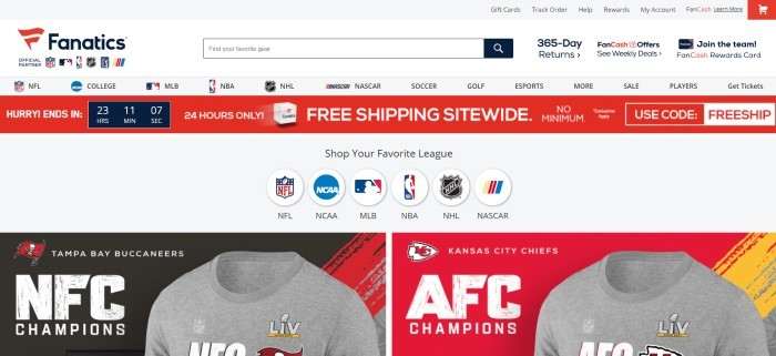 This screenshot of the home page for Fanatics has a white background and header with black text, a red announcement bar, a row of icons that shoppers can use to navigate to various league products, and two side-by-side photo advertisements of gray tee shirts with differing college logos at the bottom of the page.