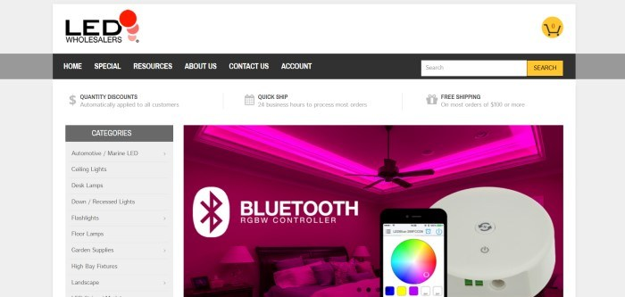 This screenshot of the home page for LED Wholesalers has a white header, a black navigation bar, a gray category list down the left side of the page, and a photo on the right side of the page showing a ceiling with magenta LED lighting and a ceiling fan, as well as a mobile phone and some white text.