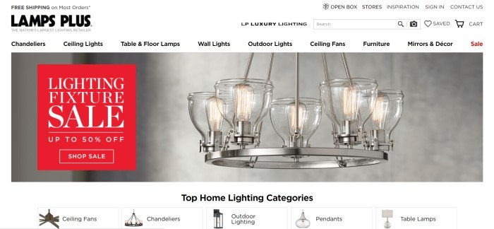 This screenshot of the home page for Lamps Plus has a white search bar and navigation bar above a photo of an interesting chandelier, as well as a red and white sales section on the left side of the page.