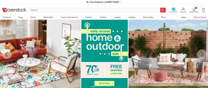 This screenshot of the home page for Overstock has a white header, navigation bar, and search bar above a main section with a photo of a well-furnished living room on the left side of the page, a well-furnished patio on the right side of the page, and a green and yellow graphic section in the center of the page.