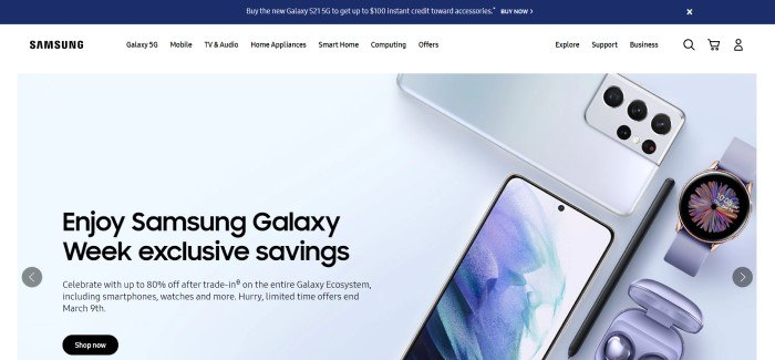 This screenshot of the home page for Samsung has a blue announcement header above a white navigation bar, along with a gray main section with photos of Samsung devices on the right side of the page and black text with a black call to action button on the left side of the page.