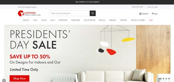 This screenshot of the home page for Y Lighting has a black header, a white navigation bar and search bar, and a photo in the main section showing a white brick wall and white couch behind an interesting lighting fixture in red, black, white, and yellow, as well as black and red text and a red call to action button.