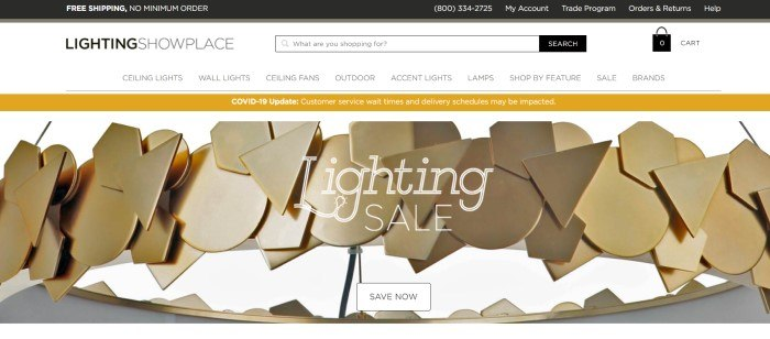 This screenshot of the home page for Lighting Showcase has a black header, a white navigation bar and search bar, a gold announcement bar, and a closeup of an interesting light fixture made from gold-colored shapes, behind white text and a white call to action button.