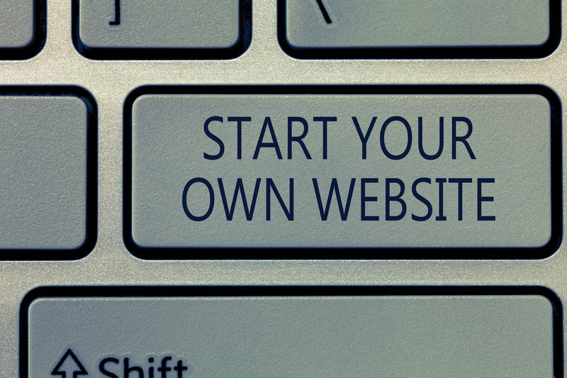 This photo shows a closeup of a key on a computer keyboard with the words 'Start your own website' on it, representing the best WordPress hosting affiliate programs.