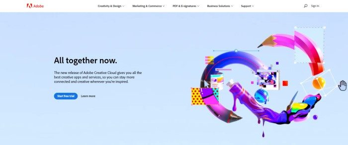 This screenshot of the home page for Adobe has a white header with black text and a red logo above a light blue main section with graphics showing how to use the program on the right side of the page and black text with a blue call to action button on the left side of the page.