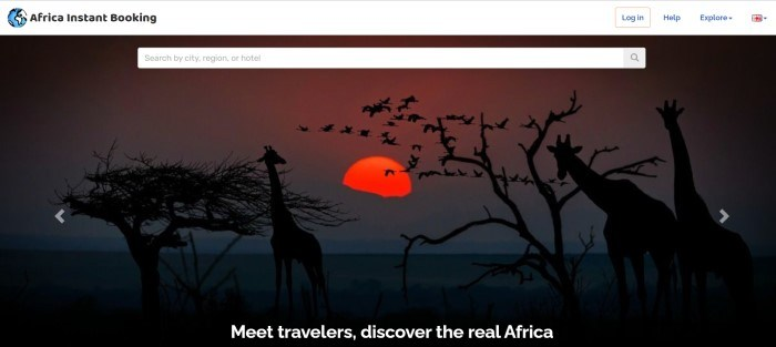 This screenshot of the home page for Africa Instant Booking has a white header, a search bar, and a large photo showing the silhouettes of giraffes and flying birds near two trees on a savannah, with a large red sun in the background.