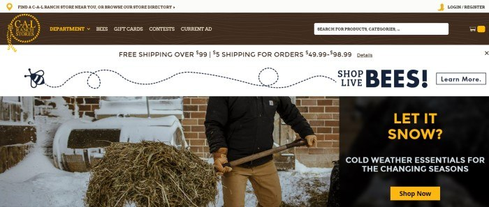 This screenshot of the home page for Cal Ranch has a dark header and search bar with a gold logo and white and gold text, above a white and black announcement bar, which is above a photo of a man carrying a pitchfork full of hay through the snow on the left side of the page, with a black text section on the right side of the page, containing white and gold text.