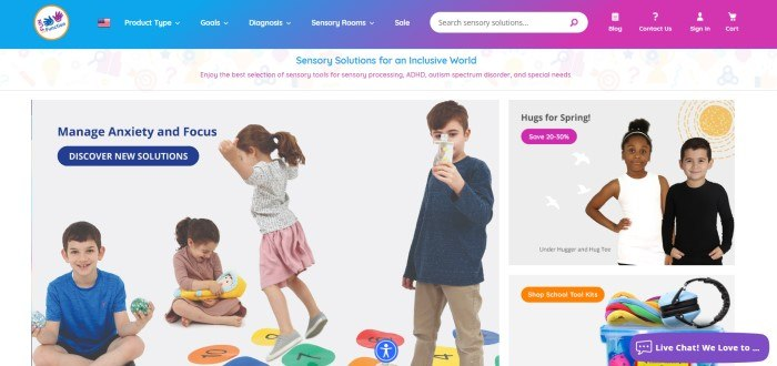 This screenshot of the home page for Fun And Function has a blue-to-pink gradient navigation and search bar with white text above an announcement section with blue and pink text, followed by photos of two children wearing hugger tees and a school kit on the right side of the page, with a group of four children playing with a variety of educational toys, behind blue text and a blue call to action button.