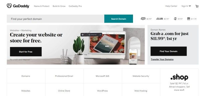 This screenshot of the home page for GoDaddy has a white navigation bar, a white and teal search bar, a photo of an open laptop on a gray desk next to a green plant and black text with a black call to action button on the lower left side of the page, and a gray text section on the lower right side of the page with a black call to action button.