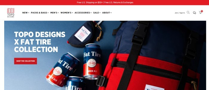 This screenshot of the home page for Topo Designs has a red header, white navigation bar, and an overhead photo with a blue background, a small bag, a large backpack in red and blue, and three red and blue cans of ale, along with white text and a red call to action button.