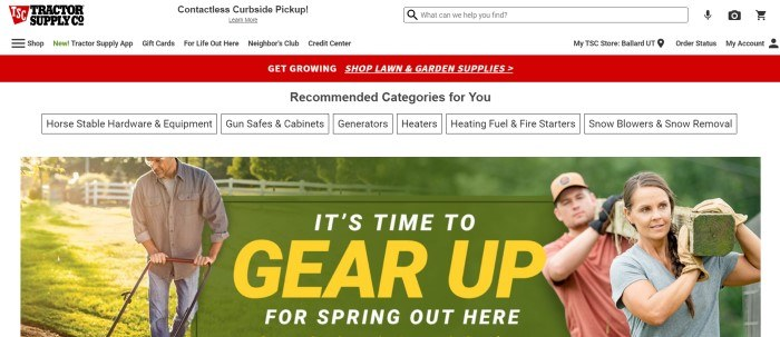 This screenshot of the home page for Tractor Supply has a white navigation and search bar, a red announcement bar, a white secondary navigation bar, and a photo of a man mowing a green lawn on the left side of the page, a photo of a man and a woman carrying a beam on the right side of the page, and a green announcement section with white and yellow text in the center of the page.