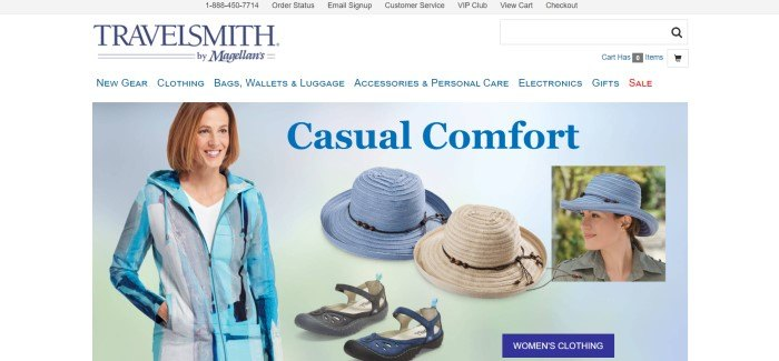 This screenshot of the home page for TravelSmith has a gray header, a white navigation bar with blue text, and a light blue main section featuring photos of a woman in casual travel clothing in shades of blue, along with a blue hat and a tan hat and a pair of sandals, behind blue text and a blue call to action button.