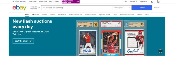 This screenshot of the home page for eBay has a white main background, search bar, and navigation bar above a teal section with white text and three photos of baseball cards.