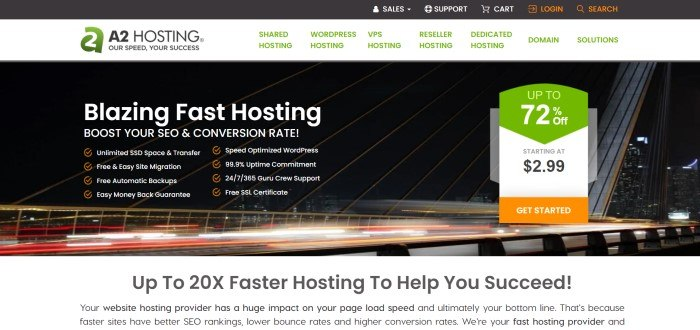 This screenshot of the home page for A2 Hosting has a black header, a gray navigation bar with green text, and a photo of a night sky above blurred headlights and taillights on what appears to be a bridge in the main section, with white text and a white and green sales announcement with an orange call to action button.