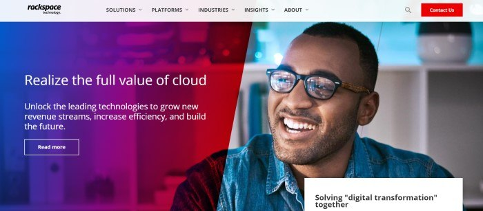 This screenshot of the home page for Rackspace had a light filter overlaying a photo of a smiling man in glasses and a denim shirt on the right side of the page, and a blue and red gradient filtered section on the left side of the page, behind white text and a transparent call to action button with a white outline.